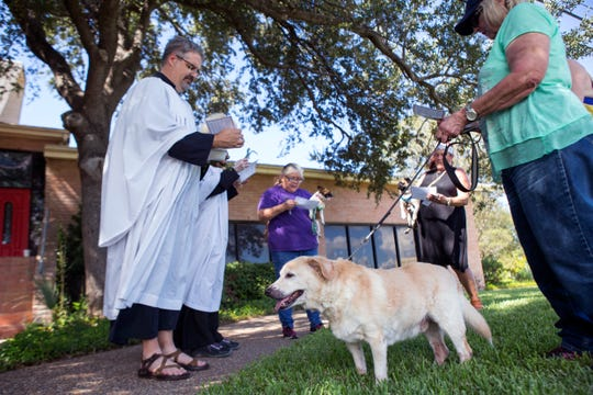 Rev. Jonathan Wickham (clockwise from left), and Rev. Cynthia McKenna preside over a pet blessing of Mary Martinez and her dog Cindy, Denise McCabe and her dog Smokey, and Maryann Krohn and her dog Gus, during the 2nd annual Drive Thru-Walk up Pet Blessing at All Saints' Episcopal Church on Thursday, October 4, 2018. The Feast Day of St. Francis', is held every year on October 4. Around this day the church celebrate the life and works of St. Francis of Assisi and his love for all God's creatures through the blessing of pets or animals.