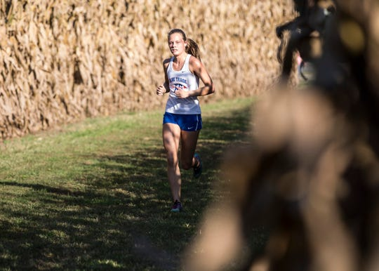 Zane Trace's Abby Mohan took first place honors for the girls at the 2018 Down on the Farm cross-country race with a time of 20:30.00.