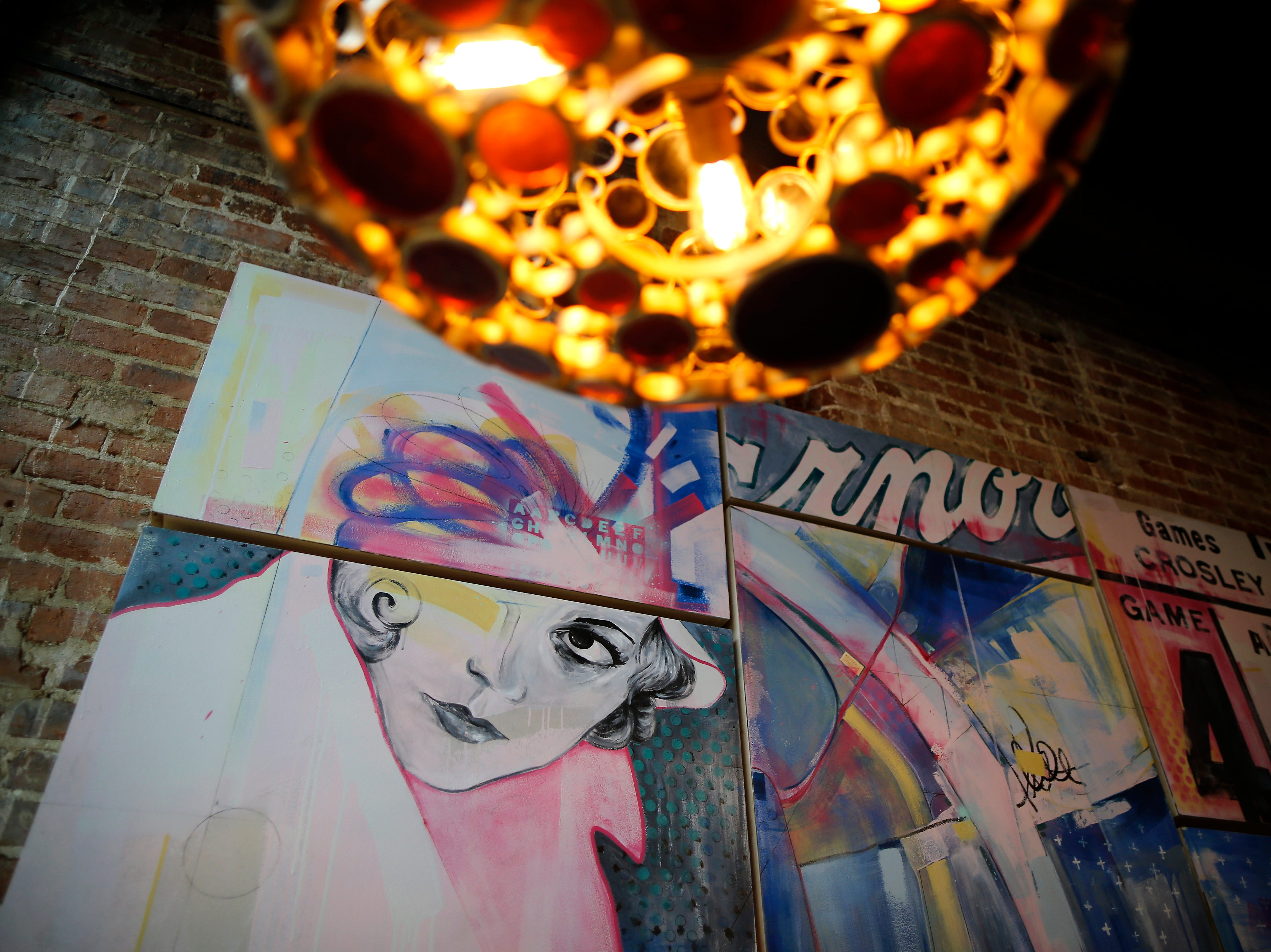 Wall art decorates the dining room at Louvino in the Over-the-Rhine neighborhood of Cincinnati on Thursday, Oct. 4, 2018.