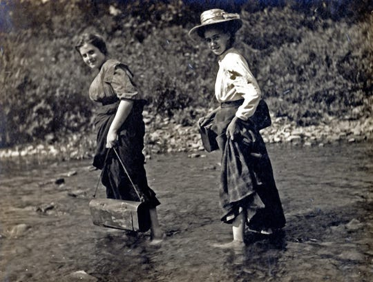 Lucy Braun (right) fords a stream during field research at Beechwood Camp, Hueston Woods, Ohio, in 1910.