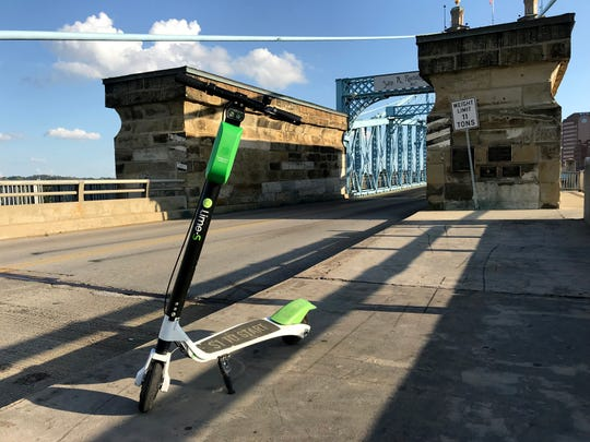 A Lime scooter left near the Roebling Suspension Bridge.