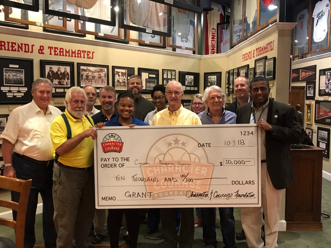 Character and Courage Foundation team members present a check to Cincinnati Recreation Commission at Green Diamond Gallery.