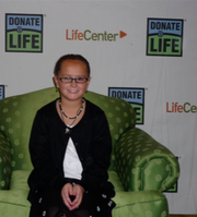 Morgan Hughes at a Donate Life function. Hughes is the recipient of two cornea transplants.