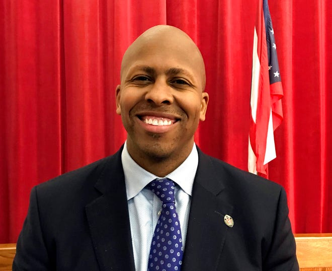 FILE - In this May 9, 2018, file photo, Democratic Ohio Treasurer candidate Rob Richardson poses for a photo in Columbus, Ohio. An Associated Press review of court filings uncovered two financial issues in the background of Richardson. Hamilton County records show Richardson's then-wife accused the Cincinnati attorney of setting up a private bank account to shield a work bonus of over $100,000 from her shortly before they divorced. Documents also reveal Richardson was sued for breach of contract in a mortgage deal in 2004. His campaign says both allegations were unsubstantiated. (AP Photo/Julie Carr Smyth, File)