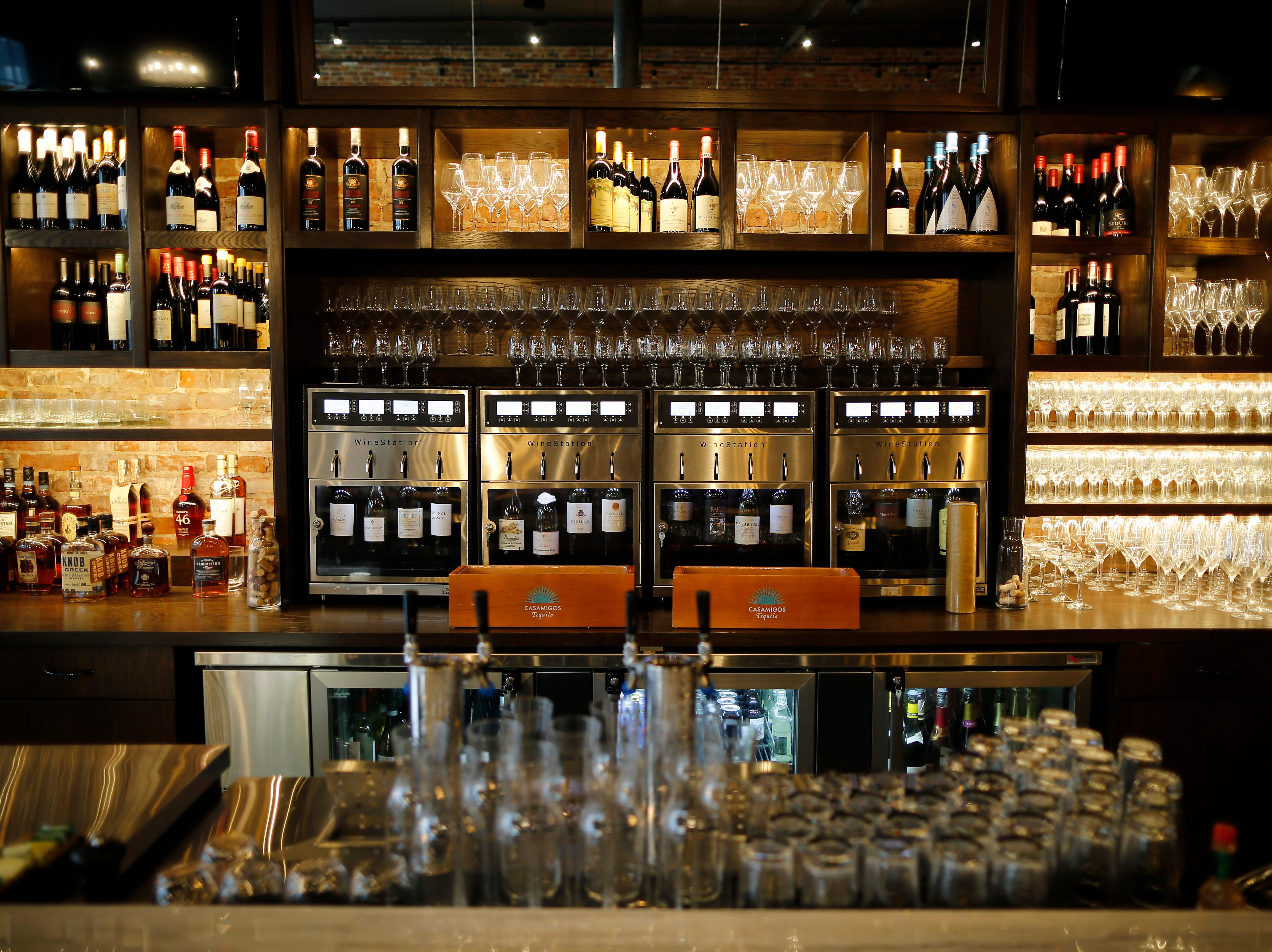 The bar and extensive wine selection at Louvino in the Over-the-Rhine neighborhood of Cincinnati on Thursday, Oct. 4, 2018.
