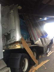 A semi in Columbus, Ohio, got stuck after striking two overhead bridges on a bike path.