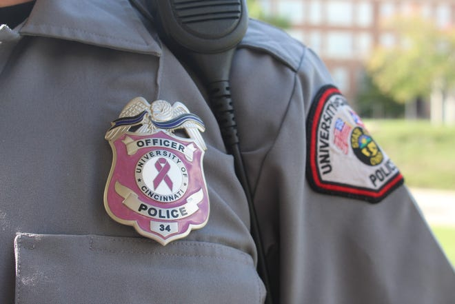 The pink badge for the University of Cincinnati Police Division is shown here.