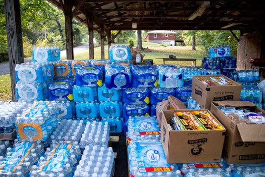 Community members bring donations of food and water for officers in the manhunt of Kirby Wallace Thursday, Oct. 4, 2018, in Woodlawn, Tenn.