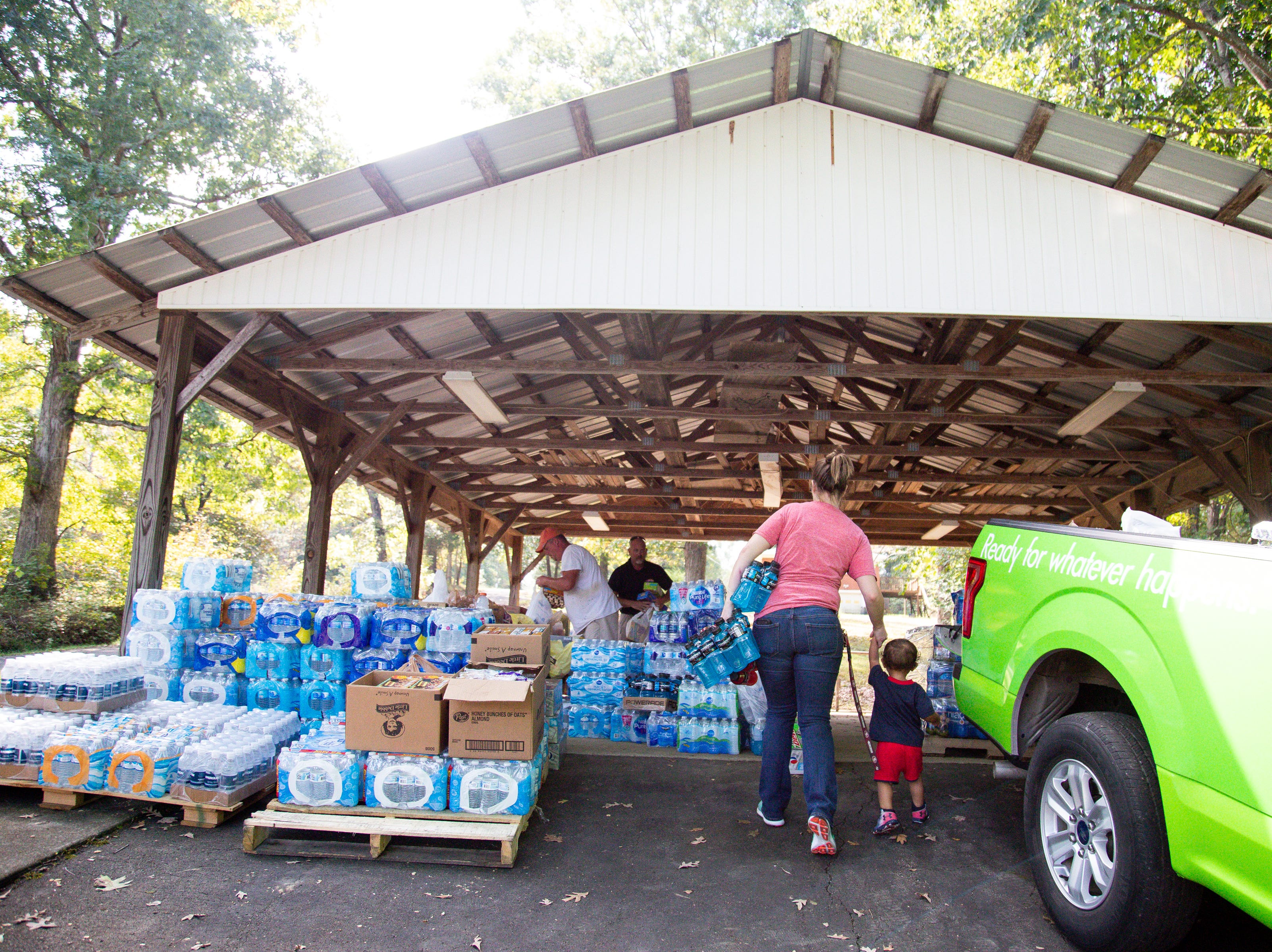 Ashlee Harper and her son Apollo, 1, bring donations for officers in the manhunt of Kirby Wallace Thursday, Oct. 4, 2018, in Woodlawn, Tenn.