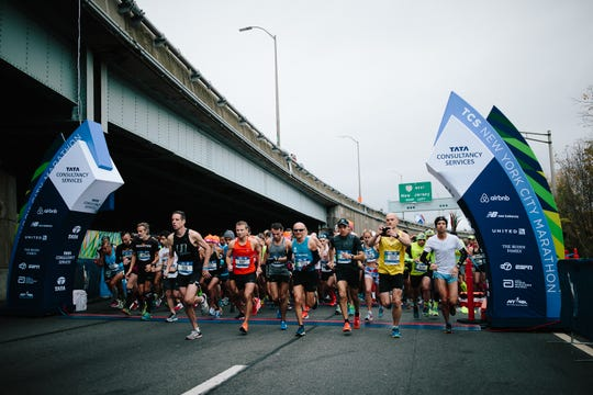 Runners at the start of the 2017 TCS New York City Marathon on Staten Island.