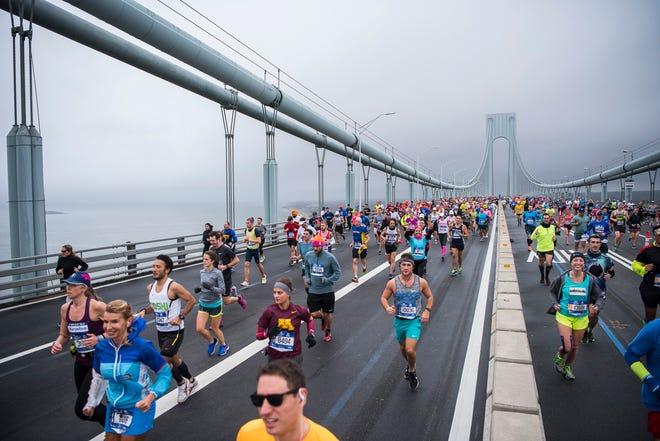 Runners at the start of the 2017 TCS New York City Marathon on the Verrazano Bridge.