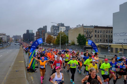 Runners at mile 13 at the 2017 TCS New York City Marathon.