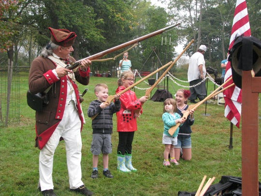 Children conducting a musket drill with wooden muskets at the Lord Stirling 1770s Festival at the Environmental Education Center in the Basking Ridge section of Bernards.