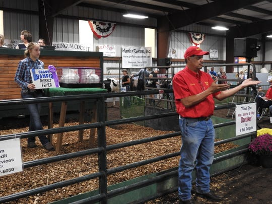 Shawn Dotsie served as a ring man during the Sale of Champions at the Coshocton County Fair, helping to spot bidders in the crowd. Madlyn Cutshall's Grand Champion Rabbit Fryers kicked off the event and were purchased by Organic Technologies for $1,200.
