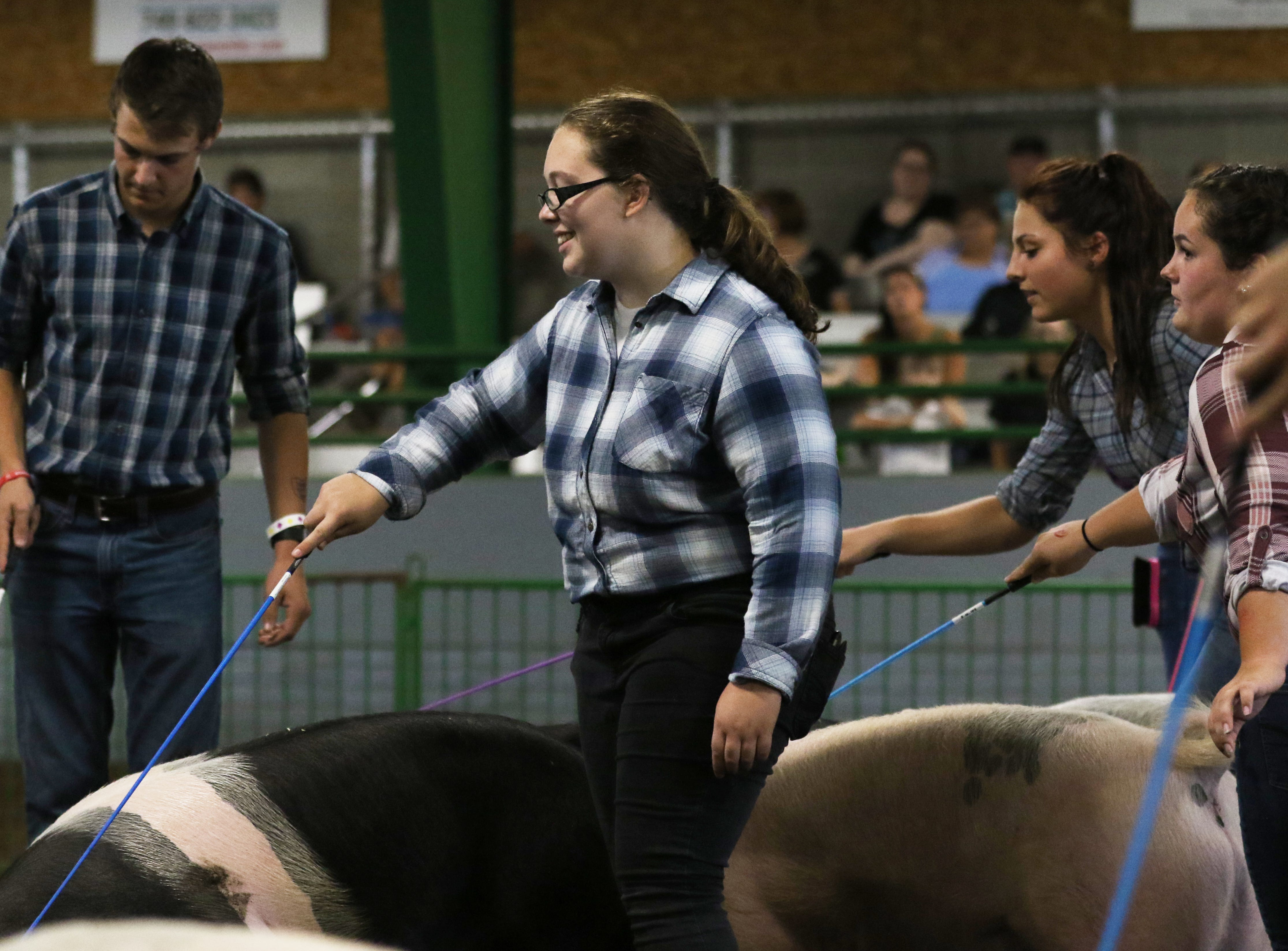 Emily Burrier shows a hog during the Showman of Showmen at the Coshocton County Fair on Wednesday.