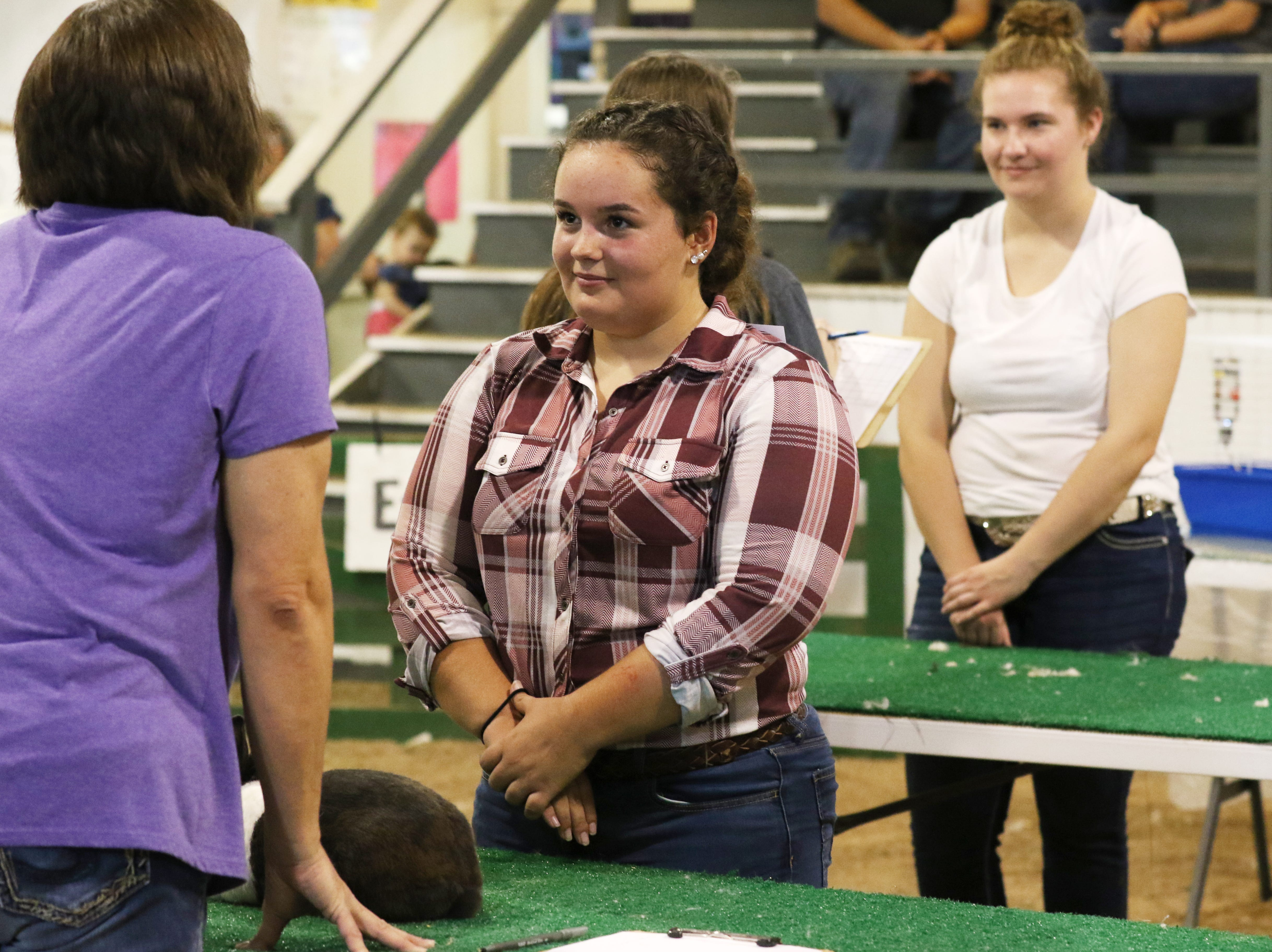 Hannah Nelson talks to a judge about rabbits during the Showman of Showmen at the Coshocton County Fair on Wednesday.