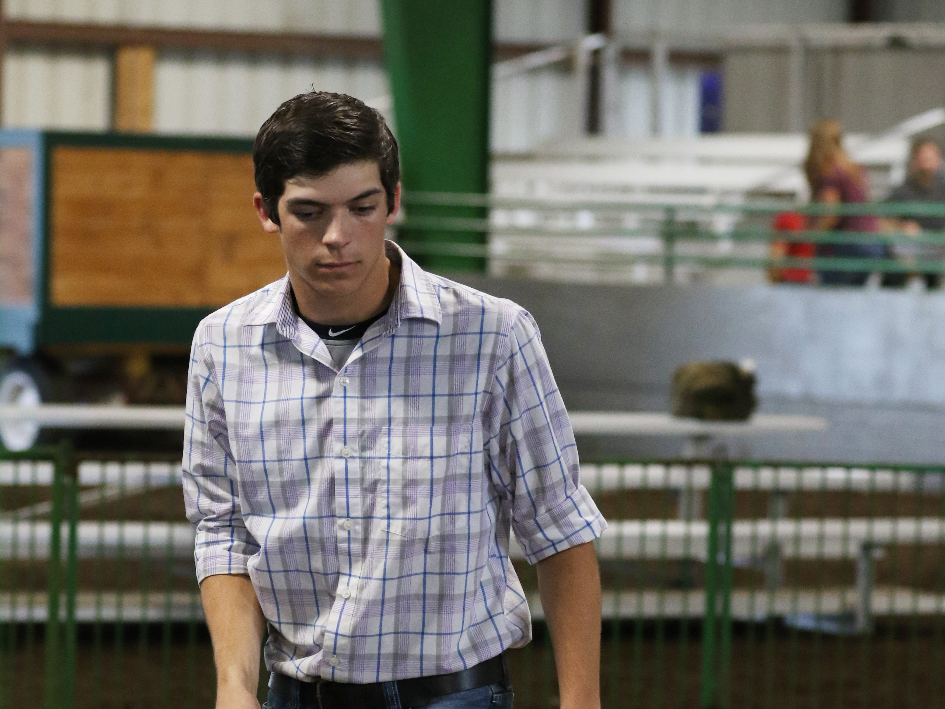 Justin Mason shows a hog during the Showman of Showmen at the Coshocton County Fair on Wednesday.
