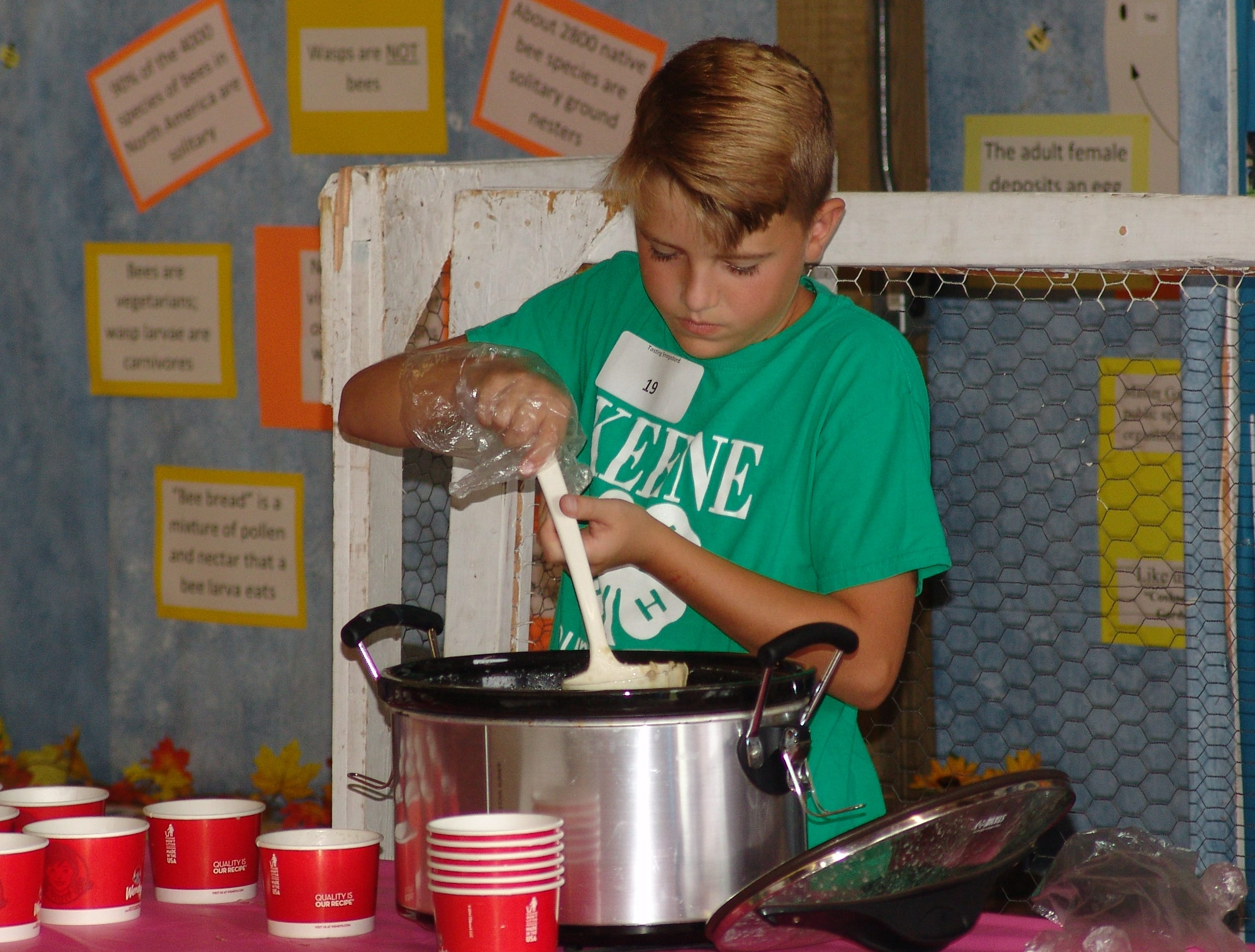 Bodey Richard prepares to serve his chicken gnocchi during the Tasting Smorgasbord at the fair.