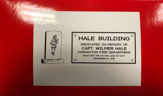 The back of the box for a Christmas Ornament of the Hale Building depicting the memorial and plaque outside the station.