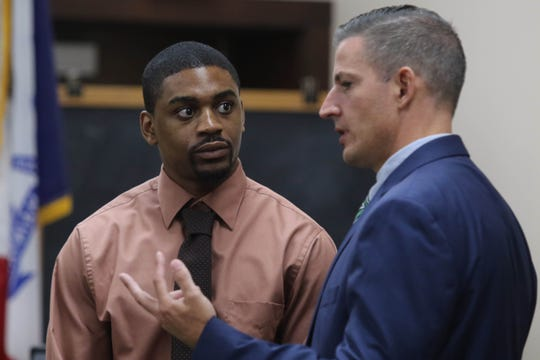 """Defense attorney Allen Cook talks with his client Jaron """"Wikked West"""" Purham, during closing arguments in the his degree murder trial, Thursday Oct. 4, 2018 in the Washington County District Courtroom in Washington, Iowa. Purham is charged with first-degree murder in the death of 16-year old Kedarie Johnson, a gender-fluid Burlington High School student who was shot to death March 2, 2016. [John Lovretta/thehawkeye.com]"""