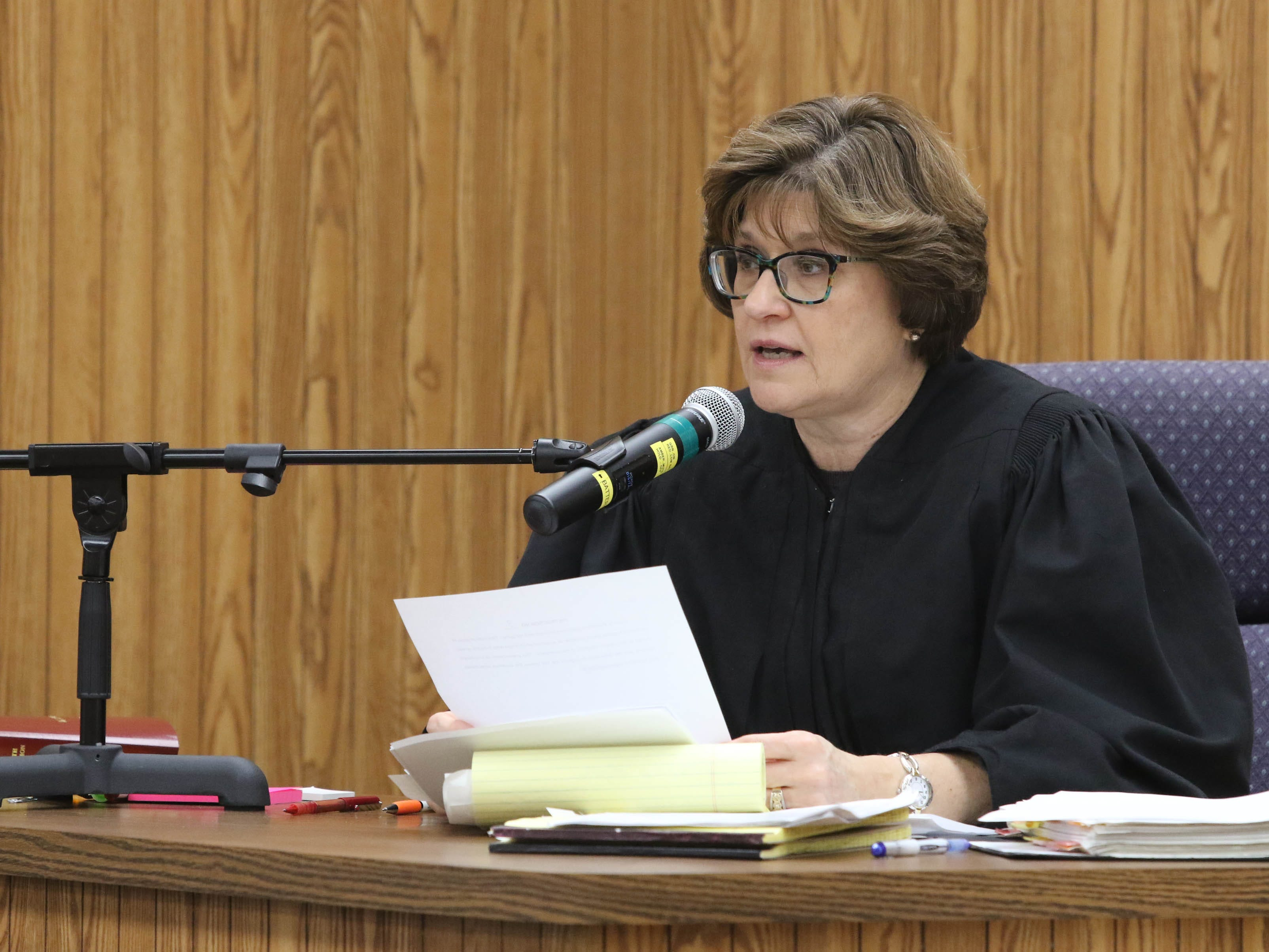 "District Judge Mary Ann Brown reads jury instructions prior to the start of closing arguments in the first degree murder trial of Jaron ""Wikked West"" Purham, Thursday Oct. 4, 2018 in the Washington County District Courtroom in Washington, Iowa. Purham is charged with first-degree murder in the death of 16-year old Kedarie Johnson, a gender-fluid Burlington High School student who was shot to death March 2, 2016. [John Lovretta/thehawkeye.com]"