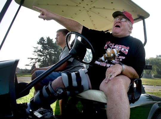 Curt Bladt, shown in 2005, used a golf cart at practice after a knee injury.