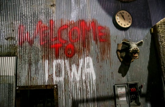 Slaughterhouse owner Ian Miller constructed a  Slipknot-themed haunt this year in Des Moines, Iowa, shown here, Thursday, Oct. 4, 2018. The audience is led through a dark slaughterhouse-style environment with designs and characters from Slipknot songs.