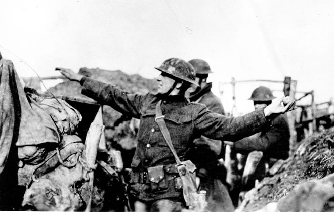 An American doughboy throws a hand grenade during World War I along the Western Front in France on March 15, 1918.
