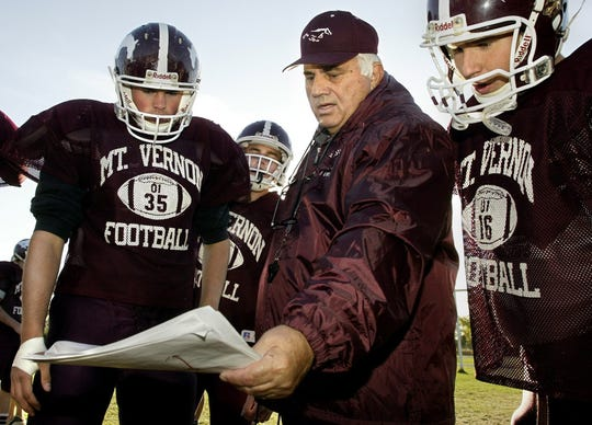 Jim Bellamy, shown coaching in 2003, won three state titles.