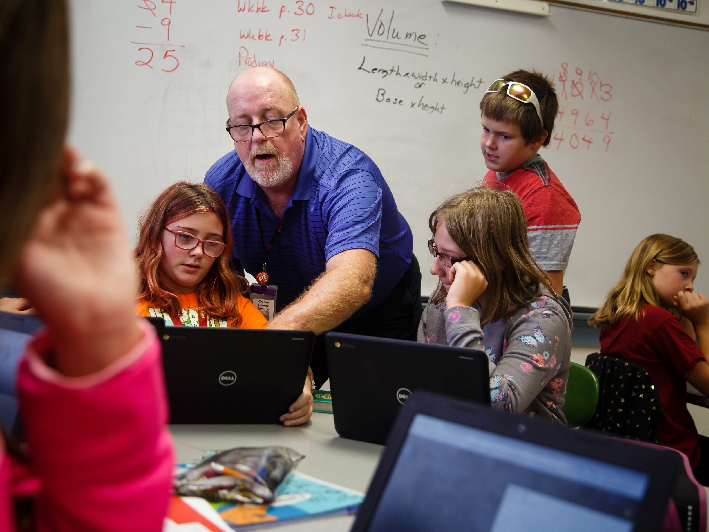 Math and technology teacher Jeff Whylie shows a class of fifth-graders how to create basic code on Wednesday, Oct. 3, 2018 in Jefferson. Whylie came out of retirement to create the curriculum which will open the doors for students to get high paying tech jobs like the ones software consulting company Pillar Technology plans to bring to downtown Jefferson.