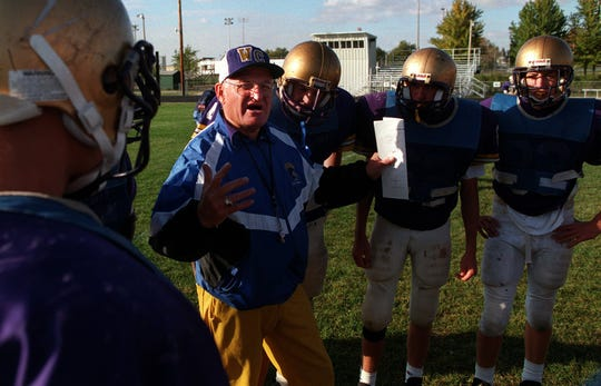 Webster City High football coach Dick Tighe, aiming for his 286th football victory, speaks to his players.