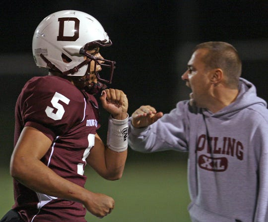 Tom Wilson (right) has won six state titles at Dowling.