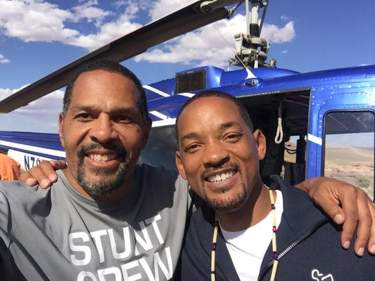 Quinn Early, former Iowa Hawkeyes receiver, poses with actor Will Smith. Quinn was part of a stunt crew that tested if it was safe for Smith to bungee jump on his 50th birthday.