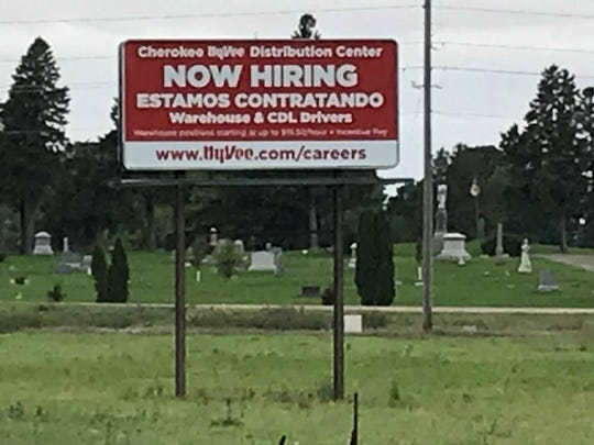 A targeted HyVee help-wanted sign on the outskirts of Storm Lake seeks Spanish speakers.