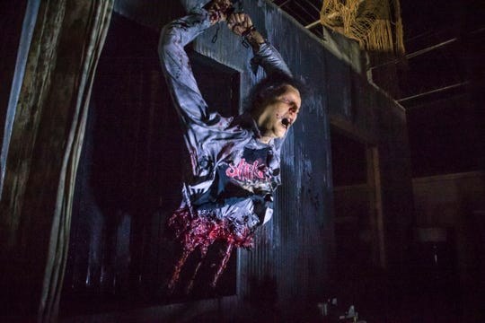 An animatronic dummy is disemboweled in the Slipknot-themed haunt in Des Moines, Iowa, shown here, Thursday, Oct. 4, 2018.