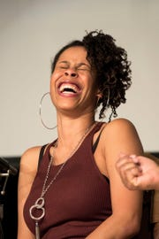 "Playwright Dominique Morisseau laughs during the ""Detroit '76"" panel discussion in April 2016 at the Charles H. Wright Museum of African American History in Detroit."