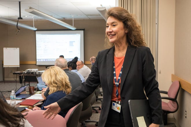 Annette Diver, GM Senior Engineering Chain Management Process Improvement Implementation Leader, speaks with a colleague after leading a training session at the GM Knowledge Center in Warren on Monday, September 24, 2018.