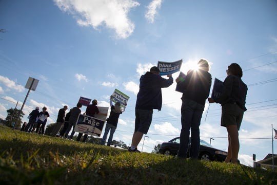 A group supporters of the Democratic Party stand along U.S. 31 in Elk Rapids on Monday, Sept. 24, 2018 waving political signs with the hopes of spreading name recognition before the November election.