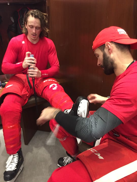 Martin Frk (left) had to untie Libor Sulak's skates after losing a game of rock paper scissors.
