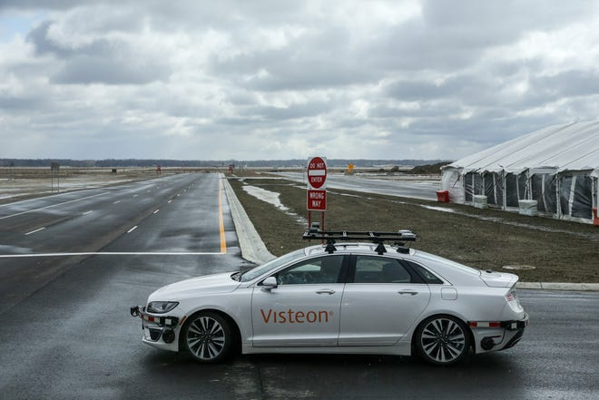 Michael Ingrody, lead system engineer for Drive Core, gives test rides in the Visteon driverless vehicle on the proving grounds at the American Center for Mobility at the historic Willow Run Airport in Ypsilanti on Wednesday, April 4, 2018.