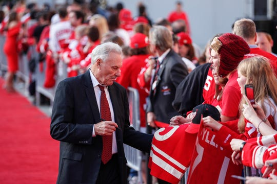 Mickey Redmond signs autographs during Hockeytown Red Carpet Walk before the season opener game against Columbus Blue Jackets at the Little Caesars Arena in Detroit, Thursday, October 4, 2018.