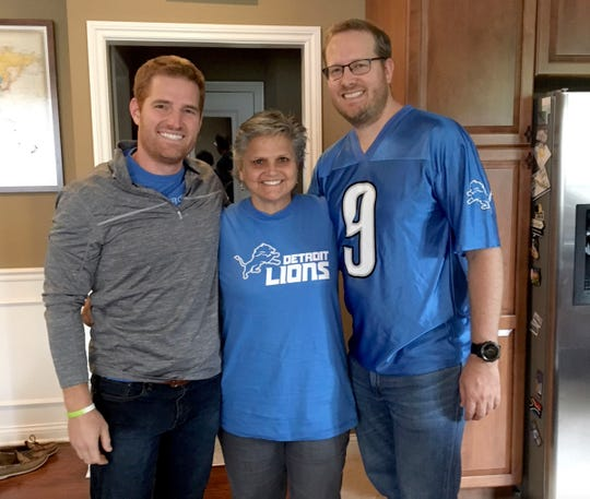 Detroit Lions fans former Macomb Circuit Court Judge Mary Chrzanowski, center, with her nephews, Mark Chrzanowski, left, and Brian Chrzanowski.