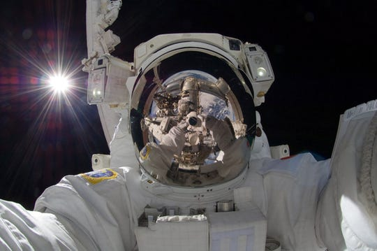 International space station astronaut Aki Hoshide takes a self-portrait while in space in 2012.
