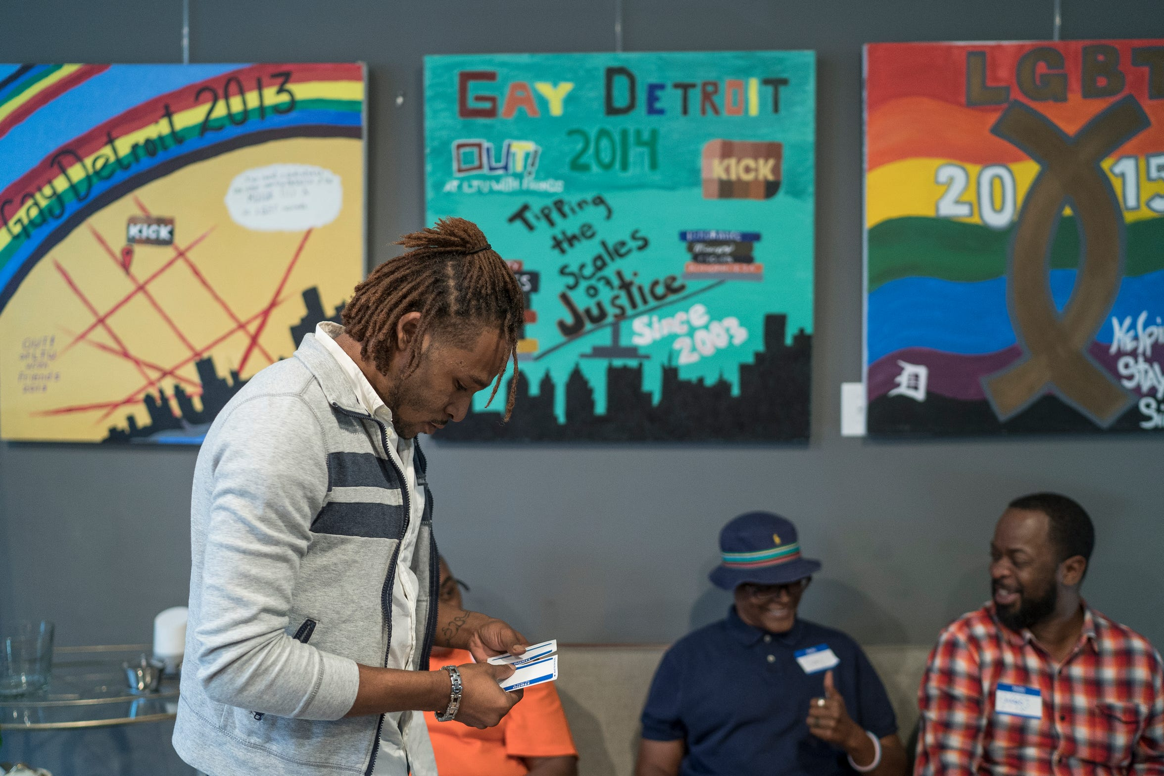 David Nelson picks up a name tag  just after he arrives for the Hotter Than July 2019 kickoff event at LGBT Detroit in Detroit, Tuesday, October 2, 2018.