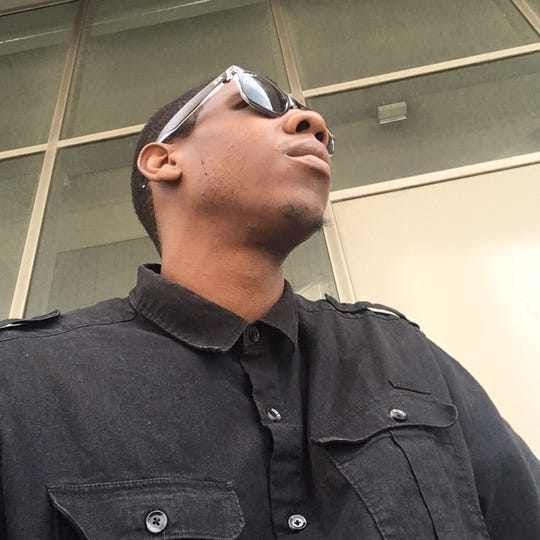 Norman Irvin, a 28-year-old Detroiter who regularly posts selfies like this one, which was taken in downtown Detroit, on his social media accounts.