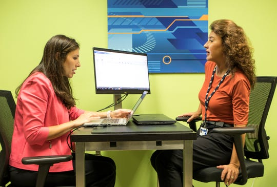 Annette Diver, right, GM Senior Engineering Chain Management Process Improvement Implementation Leader and Francesca Daniel, User Profile Management Specialist, work at the GM Tech Center in Warren on Monday, September 24, 2018.