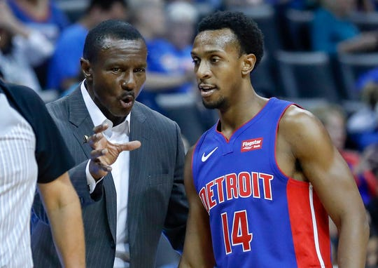 Pistons coach Dwane Casey speaks with guard Ish Smith during the first quarter at Chesapeake Energy Arena on Oct. 3.