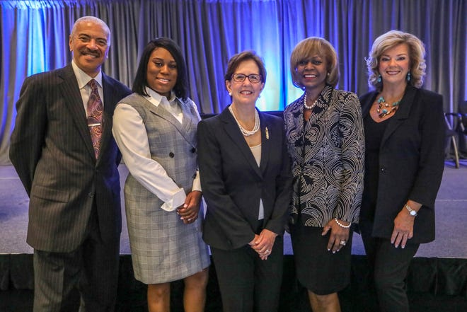Presenters Huel Perkins, left, and Carol Cain, right, stand with award recipients Dannis Mitchell, Barbara Rossmann, and Shirley Stancato during the 12th annual Shining Light Regional Cooperation Awards, sponsored by the Detroit Free Press and the Metropolitan Affairs Coalition, at the Ford Conference and Event Center in Dearborn, Mich. on Thursday, Oct. 4, 2018.