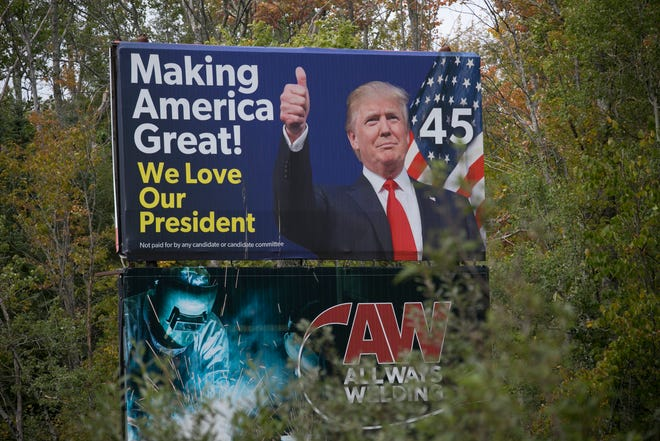 """A billboard showing President Donald Trump and claiming """"not paid for by any candidate or candidate committee"""" is on the roadside on M-115 in Selma Township."""