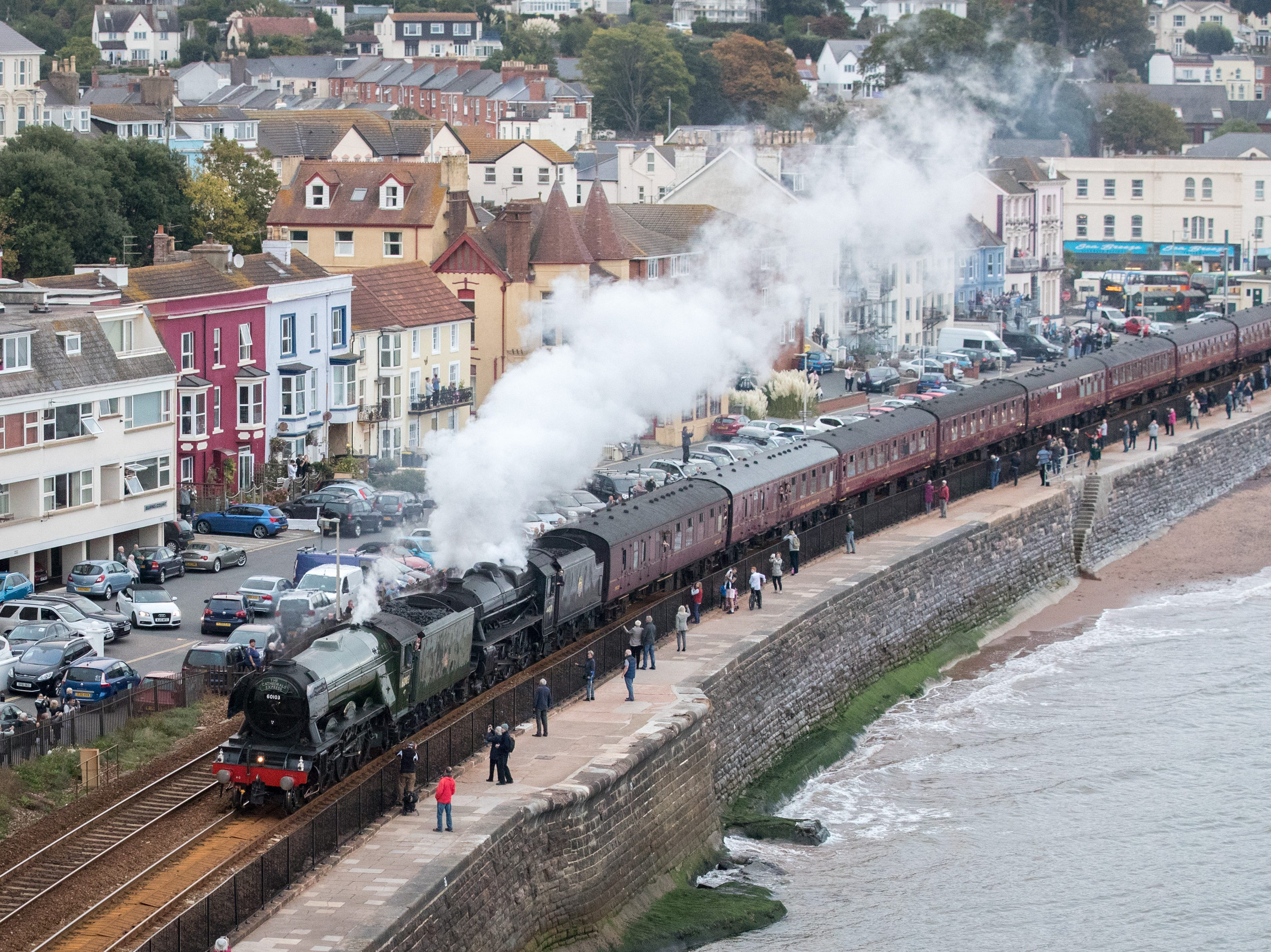 The Flying Scotsman steam locomotive, front, and the Black Five steam locomotive pass Dawlish on its way to Penzance, on Oct. 4, 2018, in Devon, England.